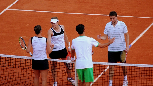 mixed doubles players shaking hands at net